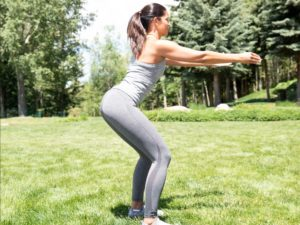 woman performing body weight squat