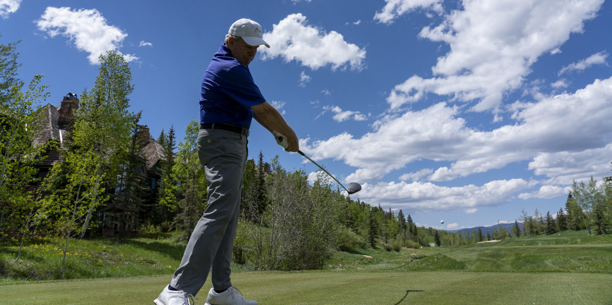 golfer on follow through with driver