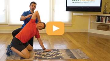 man demonstrating back exercise to help lower back, the quadruped thoracic spine rotation