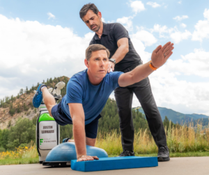 Justin Leonard performing exercises with Dr. Jeremy James to help golf game
