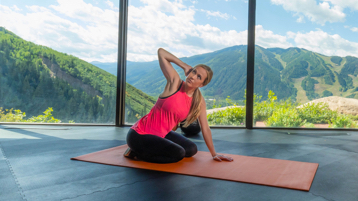 Woman stretching in front of mountains